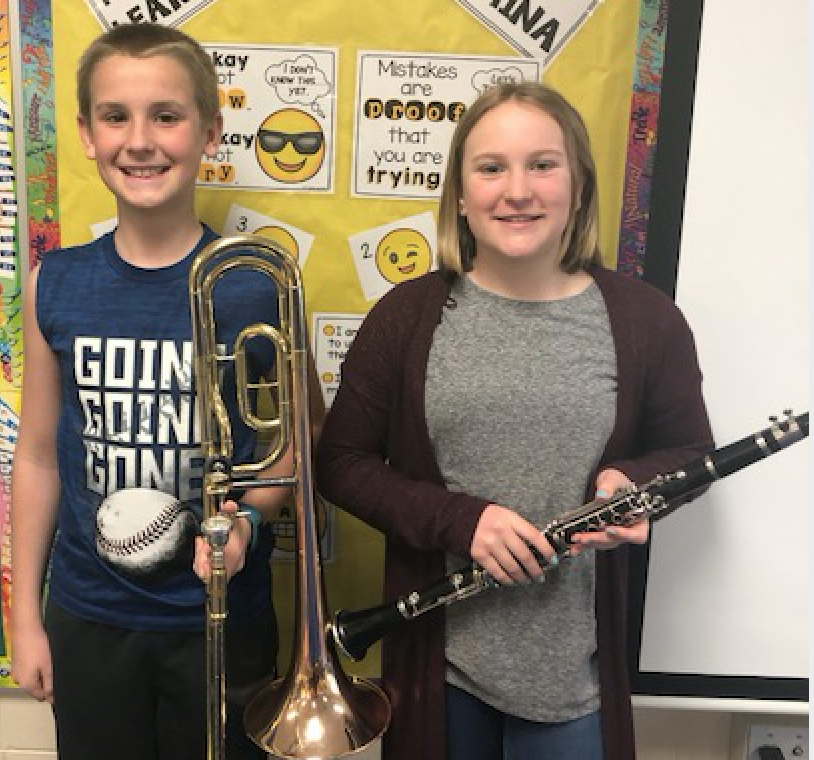 two students with instruments