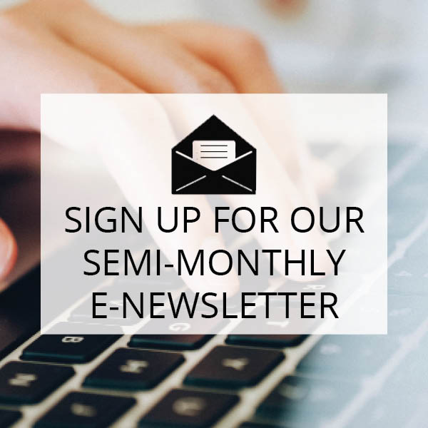 sign up for our semi-monthly e-newsletter- picture of hand typing.
