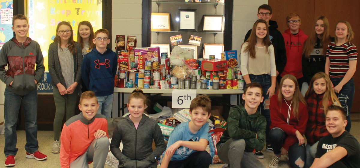 students by food drive donations